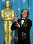 Composer Hans Zimmer holds the Oscar he won for be